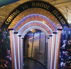"The Coming to Rhode Island exhibit at the Providence Children's Museum features a lit ""time tunnel"" with a neon entryway and rope lighting to help create the feeling of going back in time. Today's children easily connect with such presentations because of their early exposure to multimedia."
