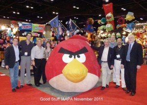 Pictured, from left to right, with the world's largest plush Angry Bird at the 2011 IAAPA Attractions Expo, are the Good Stuff Company's David Chazen, Jack Cohen, Hank Mackin, Laurie Conway, David Hyman, Bruce Gordon, Irwin Siegel and Stephen Chernin.