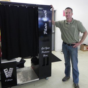 "Chad Cooke, one of the owners of Cooke Rentals in North Carolina, photographed with a photo booth. ""Right now it seems like corporate parties are still going on and for the amusement end people are still renting inflatables,"" Cooke said."