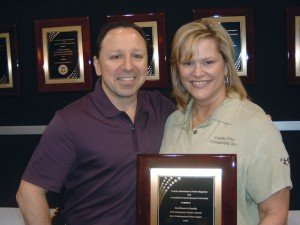 Jerry Merola of Foundations Entertainment University presented the Excellence in Family Entertainment Center Award for Best Redemption Prize Center to Lisa Chapman of the Enchanted Castle in Lombard, Ill.