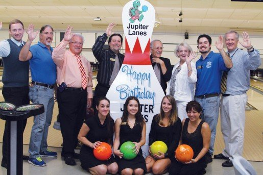 The staff from Jupiter Lanes in Jupiter, Fla., are, from left to right:  Michael Thompson, manager; Dean Lawyer, facilities manager; Douglas Moore, general manager; Duane Norman, manager; Sanford Finkelstein, league coordinator; Kathi Pizze DeMarco, special events; Daniel Lami, coach and customer service; and Gordy Woelper, community coordinator. Shown at front is the hospitality staff, from left to right: Christina DeMarco, Janine Guerra, Tamara Smith and Kelly Lafreniere. The location offers several party packages for children, adults and corporations.
