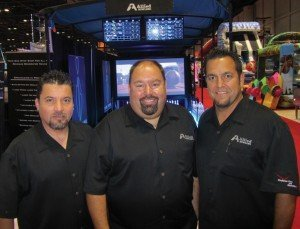 Allied Bowling Corporation's Alex Gonzalez, operations and chief technician, Mark Marchido, president and CEO and Brent Dyer, director of sales and marketing (left to right.)