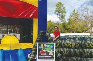 Guest Hayden on a Joust Camo inflatable at an Extreme Party Rental event. The company puts action shots of its inflatable on the website to generate interest.