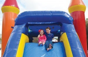 Guests Madison and Camden on a slide provided by Extreme Party Rental. New inflatables for 2014 are showing versatility and new features, according to the company.