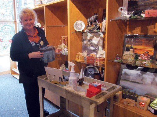 Jamee Kloster, sales assistant II, at Split Rock Lighthouse in Two Harbors, Minn., photographed with a display. The store's manager said it is important to have knowledgeable staff members that know the product line and can activity work with guests.