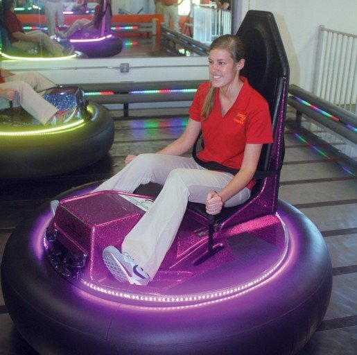 Amber Williamson, a staff member at Space Tag Entertainment Center in Ellisville, Miss. The owner installed a new bumper car arena in May from Ride Development Company (RDC).