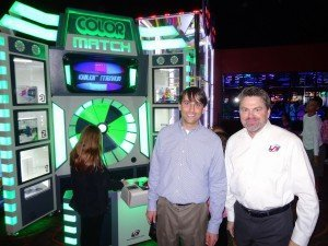 "Brian Cohen of Entertainment Properties Group and LAI's Chris Brady with Mega Color Match at Pinstack in Plano, Texas. ""Pinstack is a phenomenal location, and we are very pleased to have so many games here, including our centerpiece Mega Color Match,"" Brady said."