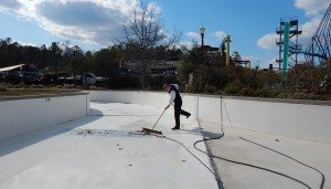 Alabama Splash Adventure President Dan Koch sweeping leaves in Warrior River. The general manager advised cleaning pools soon after the last freeze to allow time for inspections and repairs.