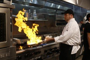"Hill Country Golf & Guitar Chef Chris Friday at work in the kitchen. ""Our guests embrace a higher-quality bar and grill experience,"" the owner said."