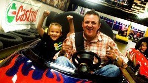 Guests photographed in a go-kart at an America's Incredible Pizza location. This Springfield, Mo., company has established a market niche for fun in a family-friendly environment.