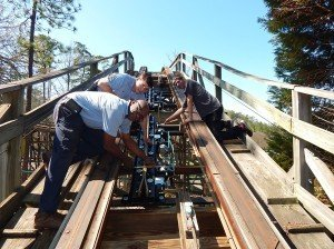 Maintenance Team Members Michael Peagler, Ken Walden and Roller Coaster Specialist Heath Kelley adjust the brakes on the Rampage ride at Alabama Splash Adventure. The park's general manager said it is important to stay abreast of waterpark regulations.