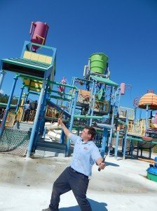 Alabama Splash Adventure Roller Coaster Specialist Heath Kelley strikes a pose in front of Castaway Island.