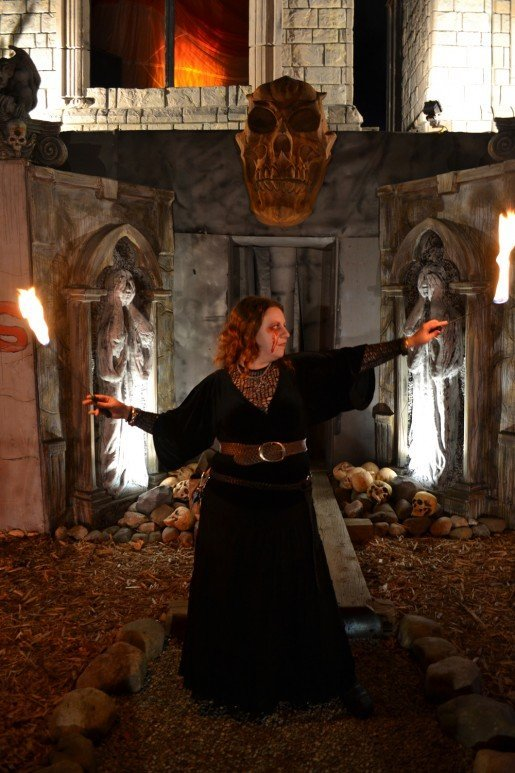 "At Saint Lucifer's Haunted Asylum in Flint, Mich., Actress Amanda Shaw is shown playing with fire in the wait line. Actors and animatronics at haunts around the country are discussed in the June 2015 TAP story ""Makeup, Masks and Motors - Finding the Right Mix of Actors and Animatronics."""