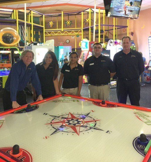 "From left to right, Manager Jim Dollina, Stephanie Loza and Karla Maravilla, arcade staff members, William Tefft, lead desk and Dean Johnson, owner, Park Lanes, Hillsboro, Ore. ""You want to put the brightest games that have flashing lights and sound closer to the arcade entrance,"" Johnson said."