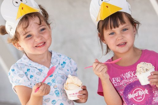 Two girls wearing duck bill hats were photographed with ice cream at the Nebraska State Fair. The fair runs for 11 days each summer in Grand Island, Neb.