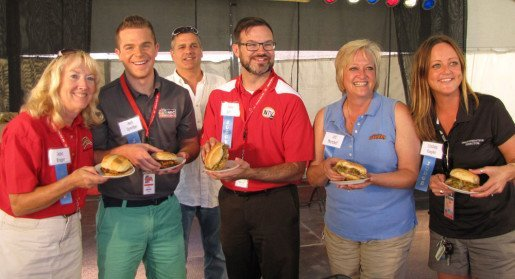 At the Nebraska State Fair, pictured are the New & Unique Food Contest judges posing with winning burgers. Shown are Jana Kruger, Nebraska State Fair Board Member, Josh Spreiter, Steve Franzman, Steve White, Jill Marshall and Lindsey Koepke.