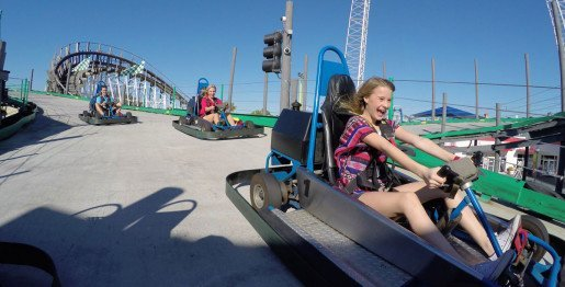 A girl riding a go-kart at Fun Spot America in Orlando, Fla. The karts were a top draw when the park opened in 1997 and remain so today.