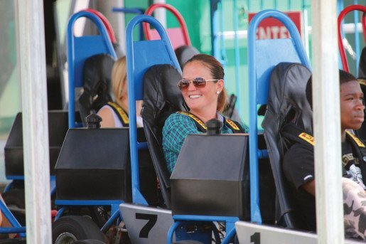 A woman waiting for a go-kart ride to start at the Orlando location of Fun Spot America. The business welcomes 2.7 million visitors annually between its Orlando and Kissimmee, Fla., locations and uses gas-powered go-karts.