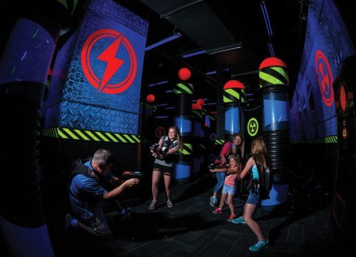 A photo from a WonderWorks laser tag arena. To satisfy hunger and keep the menu simple, the company offers classics such as chicken nuggets, hot dogs, pizzas, pretzels, nachos, popcorn, fries and chicken pitas.