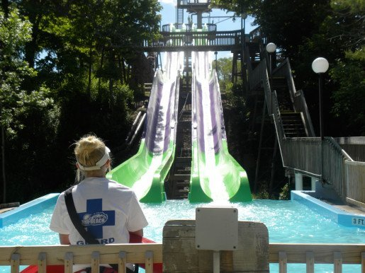 Slides with Guard Miranda Arozarena looking on at The Beach Waterpark in Mason, Ohio. Ride and attraction inspections are important spring maintenance tasks.