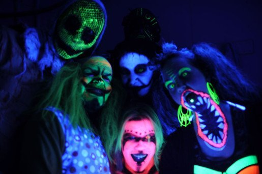 "Actors shot in blacklight at the Burial Chamber Haunted House Complex. A sign at the attraction's entrance cautions ""Punch our actors, go to jail."""