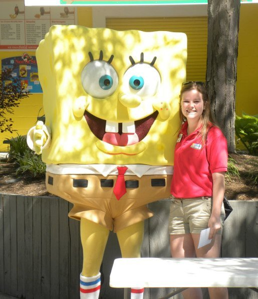 The Beach Waterpark Supervisor Kaitlyn McGowan with a SpongeBob character. Since the park is outdoors, everything from pools to tables have to be cleaned each spring.