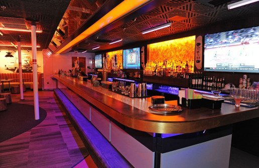Colors are coordinated at the Bowlero Mar Vista location, including the lighting hues over the concourse, lane seating areas and the bar.