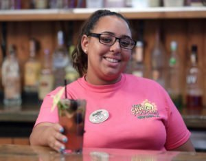 KeyLime Cove Indoor Waterpark Bartender Ivette Aviles photographed with a Dragonberry Mojito, which is a combination of fresh blackberries, raspberries and mint muddled together with dragonberry Bacardi to create a delicious cocktail.