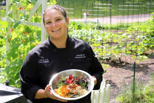 At the Minnesota Zoo, specialty salads like Asian chicken, Caesar, Cobb, Greek and Southwestern are hand-tossed to order. Shown is Executive Chef Jodie Miller.