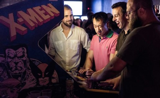 Guests photographed with a game at Joystick Gamebar. All of the center's games come from the 1970s, 1980s and 1990s. Photo Credit: Sharif Hassan.jpg