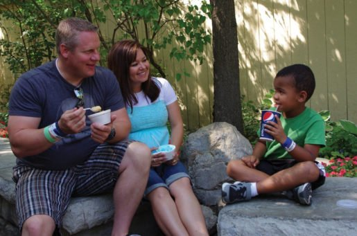 A family enjoys ice cream during the summer at Silverwood Theme Park. The park has cut back the number of flavors it offers at the Carnival Ice Creamery, and the result has been far greater sales and efficiency.