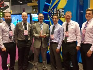 The Spectrum Sports team photographed with their award  at the 2016 IAAPA Attractions Expo.