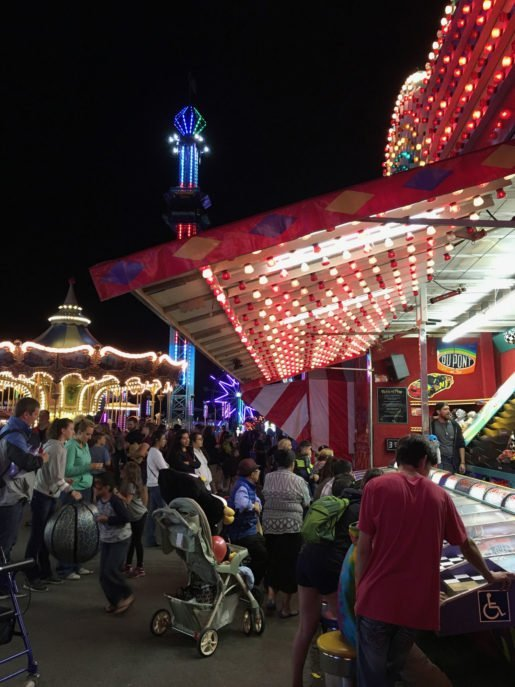Games and rides at a Golden Wheel Amusements event. The company celebrated its 50th anniversary in 2016, and brought five new rides to its route.