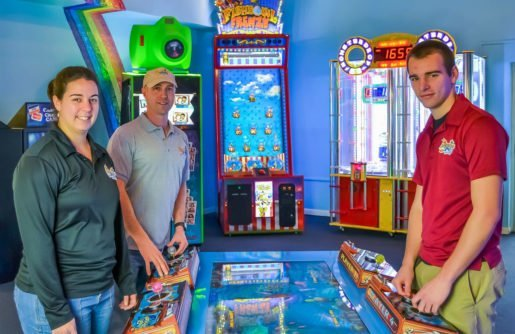 Erik Peffley, facilities manager, Jared Landis, staff member, and Alishia Landis, manager, of Adventure Sports.The center's arcade appeals to all ages.