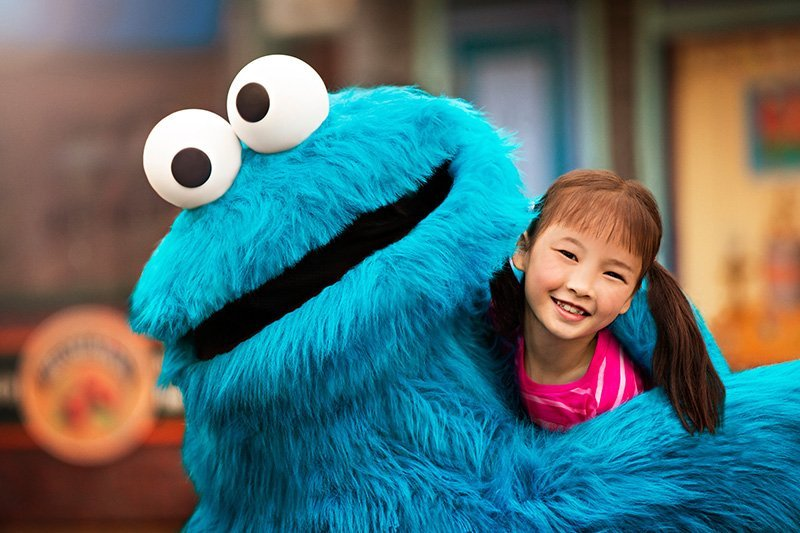 A Cookie Monster character and guest photographed at Sesame Place. The September/October edition of TAP contained major news on the start of the busy fall trade show season, including a look at some of the top industry vendors. Photo credit: Sesame Place®