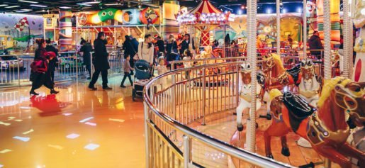 Customers photographed at a Funky Town location, with a carousel at right. A top operator in the region, EMC, LLC, began developing and managing family entertainment centers in 2007.