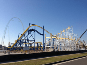 Here is a current photo of the construction at Fun Spot America in Orlando, Fla. In the foreground is White Lightning, the park's wood roller coaster being built by GCI. Freedom Flyer is the name of the steel suspension coaster being built by Chance-Vekoma. Unnamed is the 250-foot, arched SkyCoaster. The attraction's grand re-opening is Saturday, June 8, 2013.
