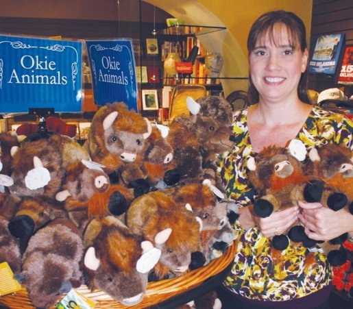 Assistant Manager Jennifer photographed in the Oklahoma History Center store with a plush bison display. The state has a long association with the animals and the first national preserve for bison was founded in Cache, Okla.