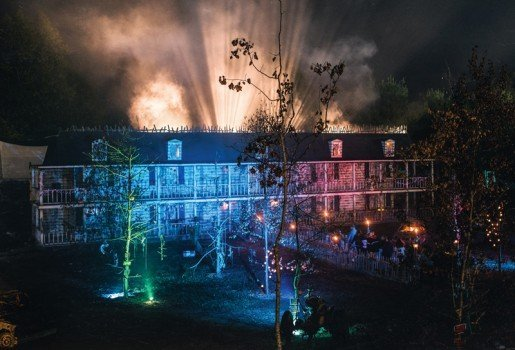 The Brigham Manor façade and attraction at Nightmare New England in Litchfield, N.H. Thanks to computer-generated technology, the windows feature images such as zombies trying to claw their way out.