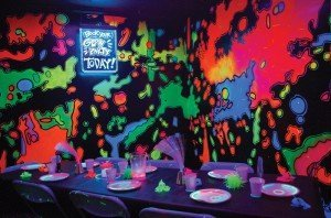 A blacklight glow room can be used for parties at the Carousel Family Fun Center for a $50 upgrade. The room's walls are painted in glow paint, and the party guests get a bracelet, necklace and a glow stick.