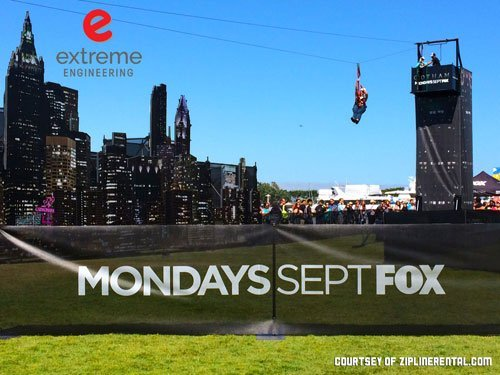 Attendees of Comic-Con® ride the Gotham City-themed portable zipline by Extreme Engineering.