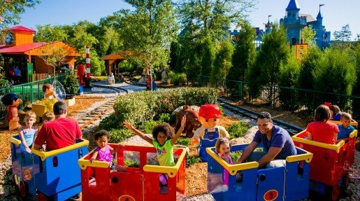 Guests enjoy the train ride at the new DUPLO Valley attraction at LEGOLAND Florida. Also available to guests of the attraction are a mini tractor ride, a water play area and an air-conditioned play area.