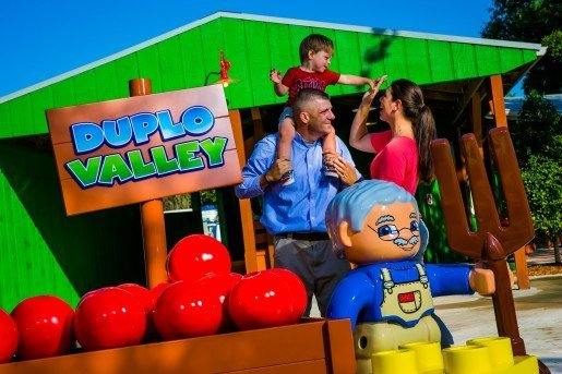 Guests photographed with a DUPLO Valley sign at LEGOLAND Florida.  The area was new in the summer of 2014 and is a great entertainment option for 2 to 5 year olds.
