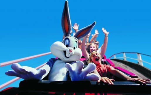 Bugs Bunny tries a ride with guests at Six Flags Great America in this promotional photo. The park was built to celebrate the bicentennial of the United States and was specifically designed to represent different regions of the country.