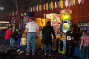 Guests enjoying the arcade games at Big Wheel Roller Skating Center.