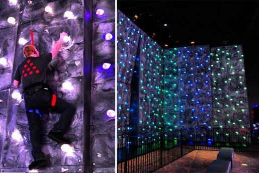 A Spectrum Sports rock climbing wall at PINSTACK spans 24 feet with six climbing stations and offers difficulty ranges from beginner to expert with two inverted climbing routes.