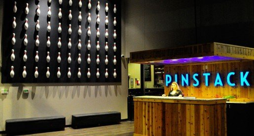 This area of PINSTACK features a striking bowling-themed décor element. In order to meet PINSTACK's entertainment goals, all staff members are trained in the operational philosophy, as well as in its five core values: integrity, respect, service, excellence and fun.