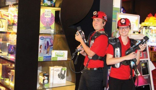Justin Polley and Megan Pool posing with the prize display case at Andy B's, in Springfield, Mo. The center has  approximately 64 game stations in its arcade.