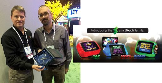 Theo Sanders and Mark Easte with Embed's IAAPA Brass Ring Award. Video playback, advanced ticket management, dual speaker audio, a toughened touch-screen supporting service, installation modes via a smartTouch interface and Embed's award-winning Color-Glo technology make smartTouch an advanced product family.