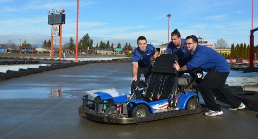 Kyle Perin, attractions attendant, Sam McNamara, attractions lead, and Nick Harper, guest services, of Triple Play Family Fun Park in Hayden, Idaho, photographed on the go-kart track. See the Entertainment Center Report for the best fun center coverage.
